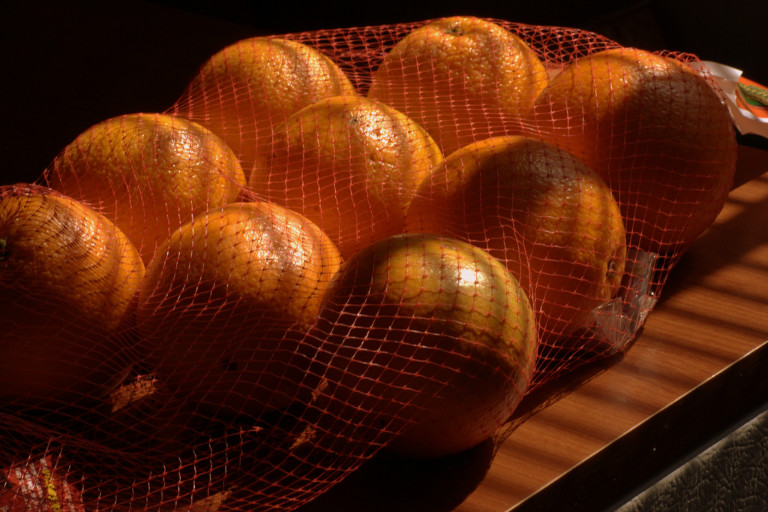 oranges in a netting bag